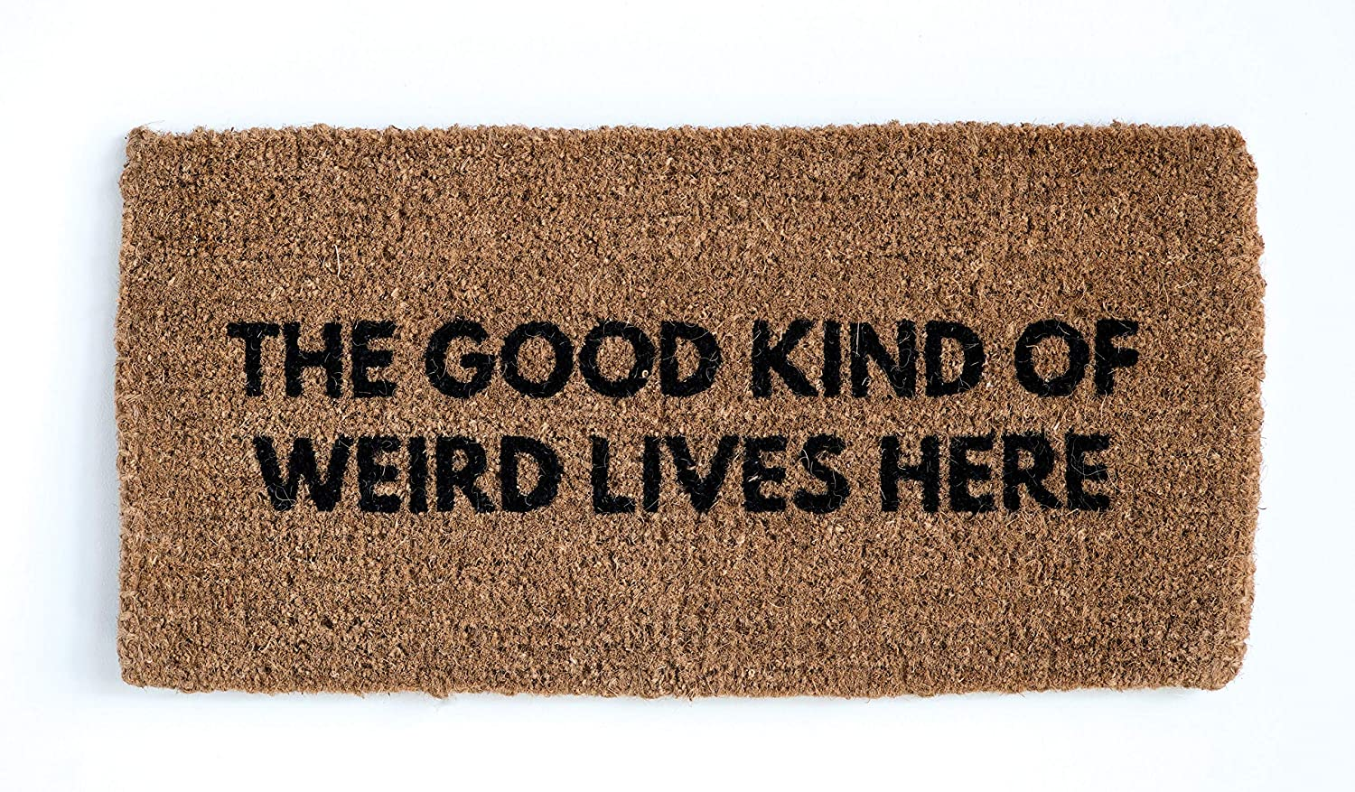 The Good Kind of Weird Lives Here doormat - a whimsical statement for your home's front door or back door to make visitors smile.
