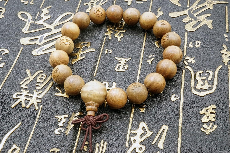 oraci/ón budista. Pulsera el/ástica Mala de cuentas de s/ándalo de 12 mm para meditaci/ón tibetana