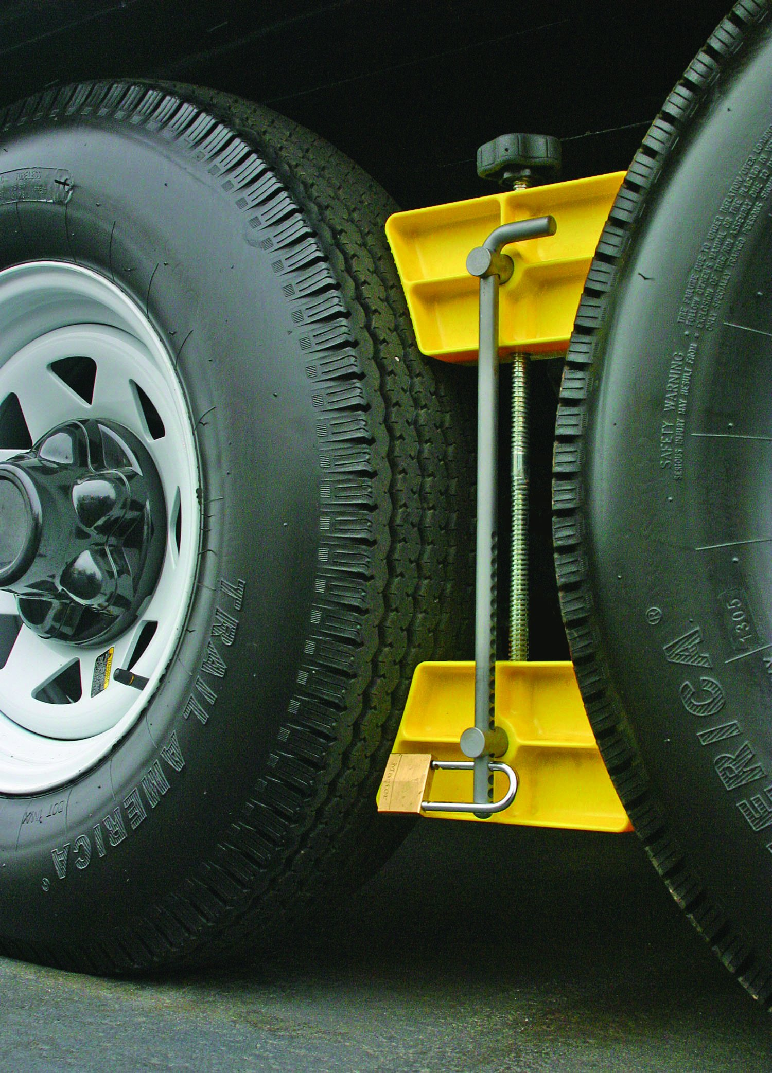 Camco RV Wheel Stop with Padlock- Stabilizes Your Trailer by Securing Tandem Tires to Prevent Movement While Parked- 26'' to 30'' Tires- Large (44642)