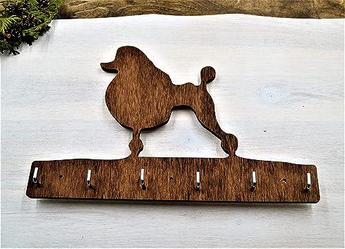 Poodle dog leash holder