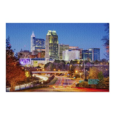 Raleigh, North Carolina - Skyline at Night with Lit Buildings 9005338 (Premium 1000 Piece Jigsaw Puzzle for Adults, 20x30, Made in USA!): Toys & Games