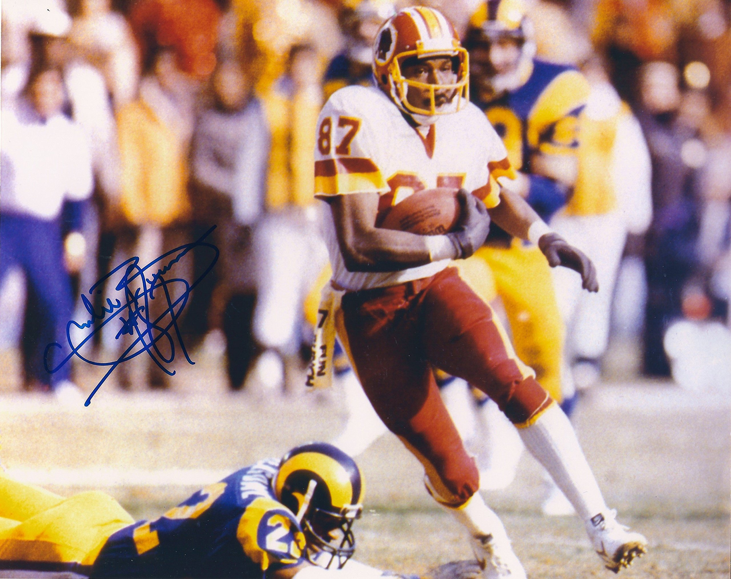 Autographed Charlie Brown 8x10 Washington Redskins Photo.