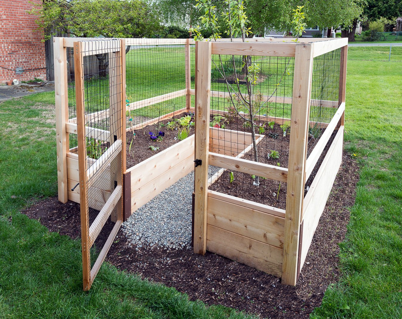 """Deer-Proof Just Add Lumber Vegetable Garden Kit - 8'x8' 2 DOES NOT INCLUDE LUMBER. Kit includes everything but the lumber: 8 Raised bed brackets, black nylon netting for fencing/trellis, black vinyl-coated steel wire for gate, ceramic-coated rust resistant screws, plus all other required hardware and detailed instructions Buy your own rough lumber locally - Build the ultimate vegetable garden with this kit. Required rough construction lumber : (10) 2""""x10""""x8'; (1) 2""""x10""""x6'; (6) 2""""x4""""x12'; (2) 2""""x4""""x8'; (3) 2""""x2""""x12'; (1) 2""""x2""""x8'; (4)1-5/8""""x1-5/8""""x12' (actual size). Note: the lumber boards will need to be further cut into the sizes described in the assembly instructions Gated garden keeps out deer, rabbits and dogs"""