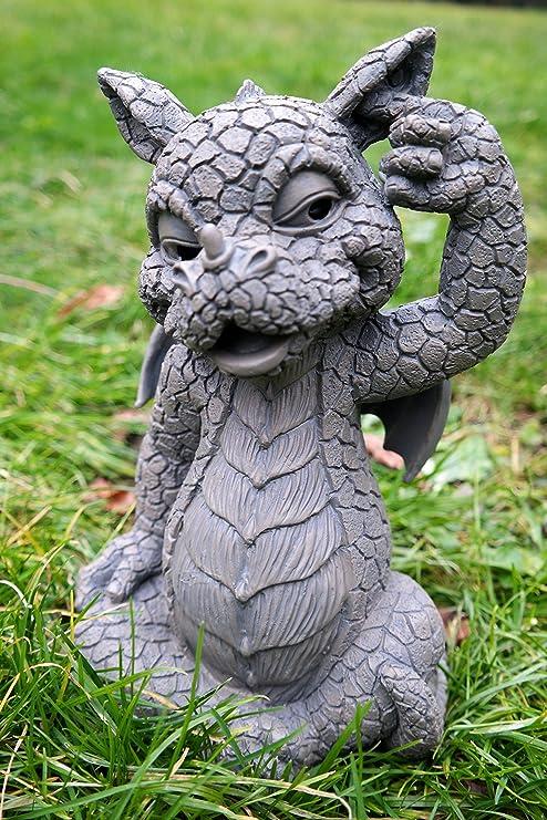 Figura decorativa de dragón de jardín desconocido que se araña en la oreja: Amazon.es: Jardín