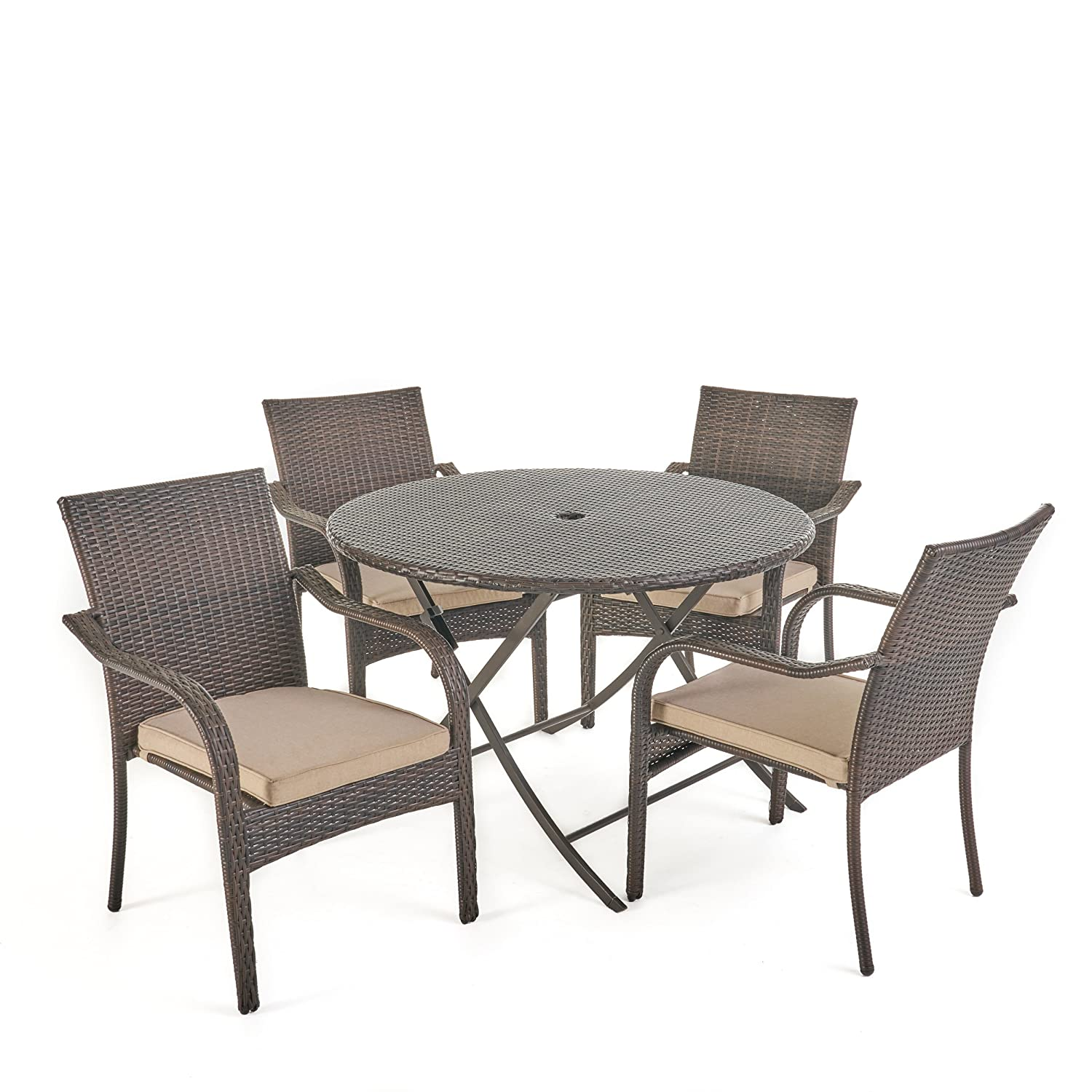 Amazon com toluca patio furniture 5 piece outdoor dining set folding table and stacking chairs premium wicker water resistant cushions in textured