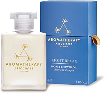 Aromatherapy Associates Light Relax Bath and Shower Oil, 1.86 Fl Oz, blended with the finest high-altitude grown Lavender, prized Ylang Ylang and nurturing wood notes of Petitgrain.
