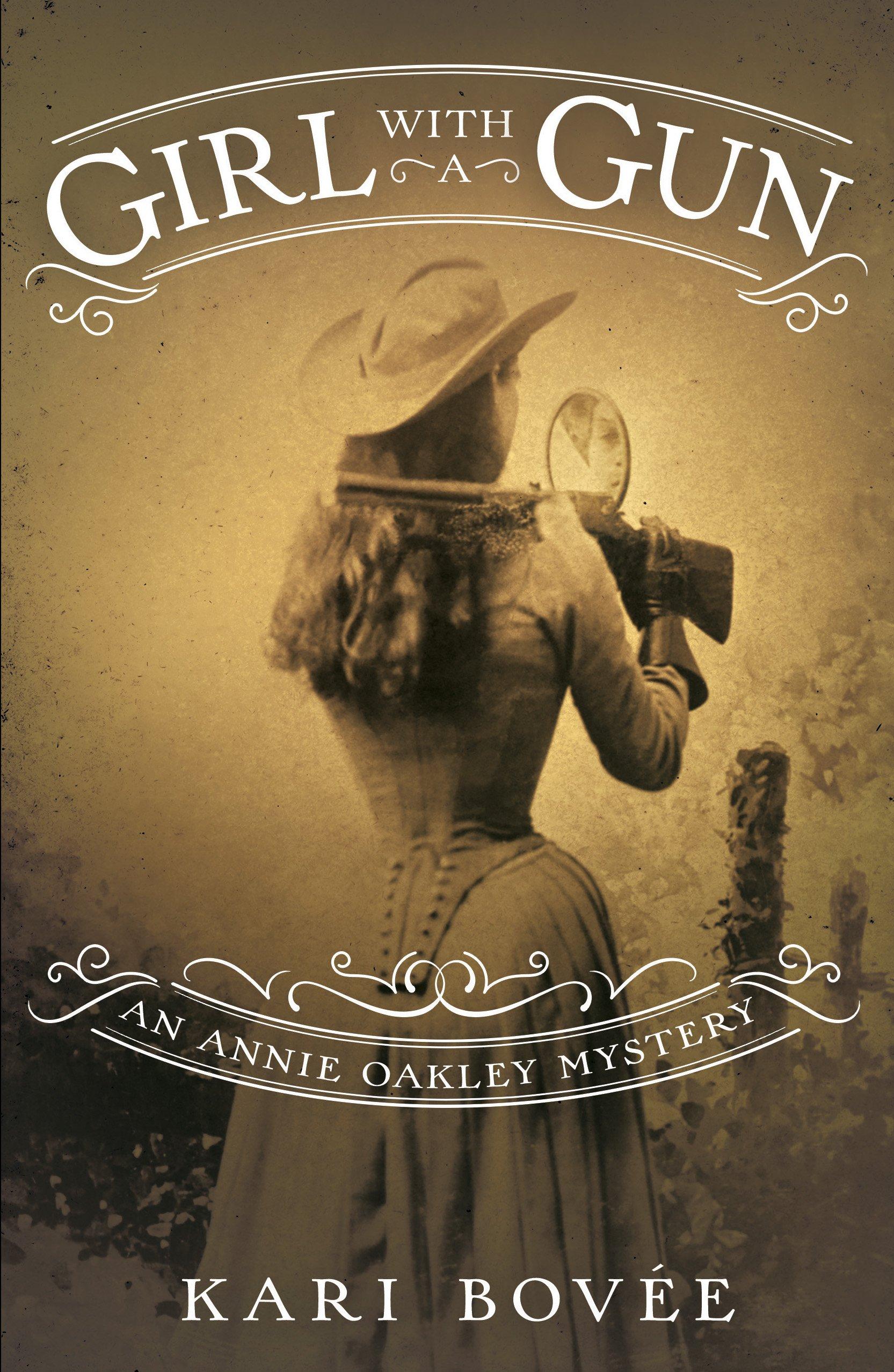 42a39f3a451 Amazon.com  Girl with a Gun  An Annie Oakley Mystery (9781943006601 ...