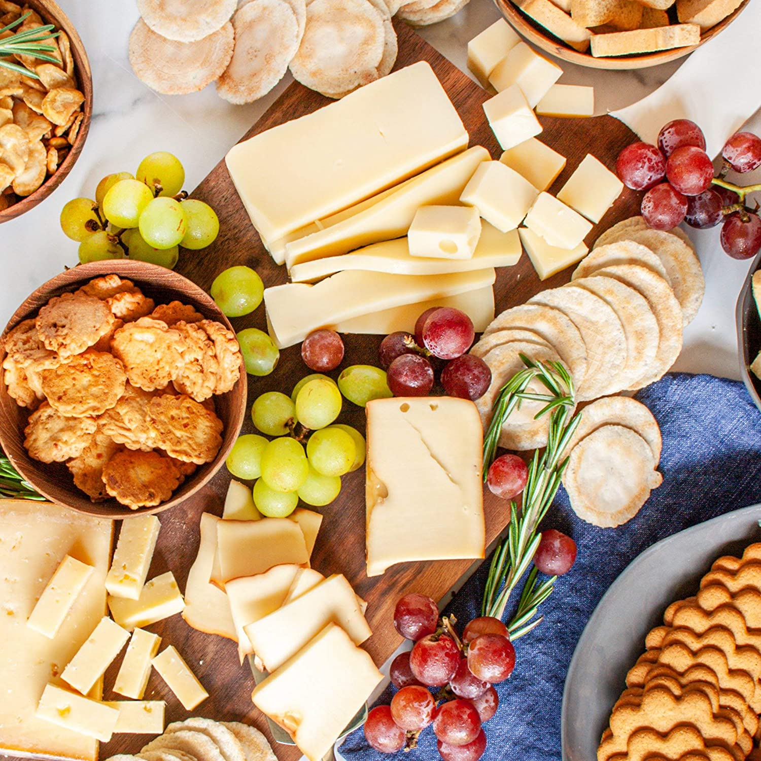 igourmet food sampler filled with International specialties - picnic perfect - includes an assortment of gourmet world cheeses, fried fava Beans, mini toasts, water crackers, shortbread cookies, sweedish gingersnaps and more