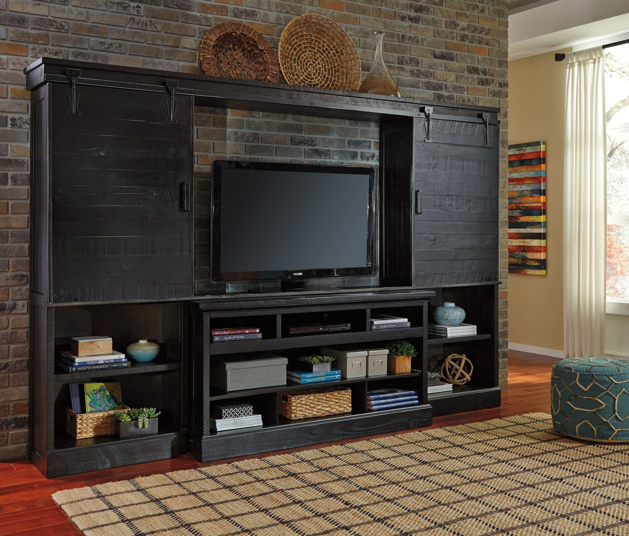 Ashley Sharlowe Collection W635-30 64'' Large TV Stand with Fireplace and Audio System Capability Open Storage Shelves Constructed With Pine Solids and Veneers in
