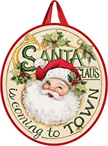 Studio M Coming to Town Winter Christmas Door Décor Decorative Front Door Sign with Colorful Ribbon Hanger, Durable Fade Resistant PVC, Made in The USA, 17.25 x 19.75 Inches