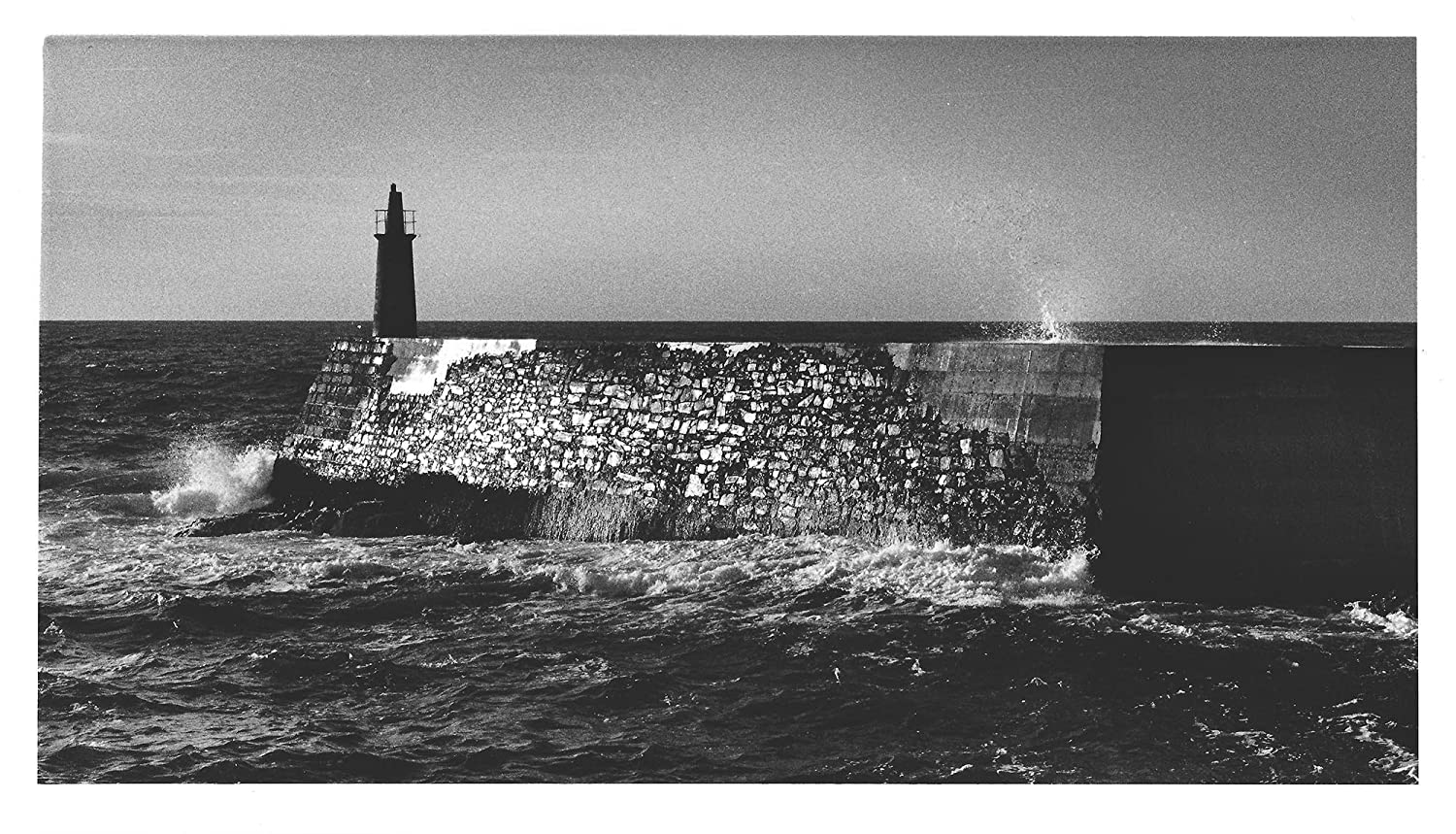 Panoramic landscape of a lighthouse of asturias analogue