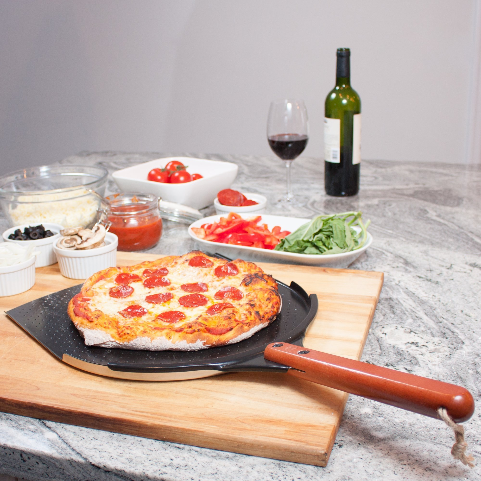 The Ultimate Aluminum Pizza Peel. 14'' Paddle with a Smooth Ceramic Coating, 10'' Wood Handle. Large & Lightweight, Use this Metal Spatula for Baking Pizzas and Breads on Oven & Grill by Love This Kitchen (Image #9)