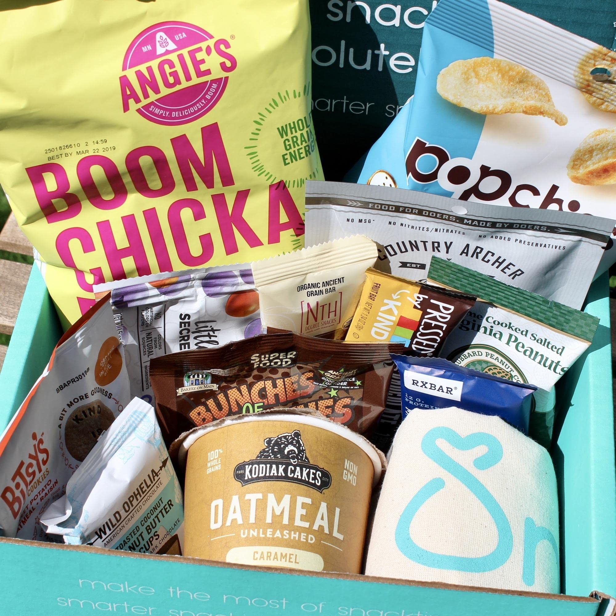SnackSack Subscription Box. Click through to find Humor, Gifts for Mamas and Grads + Books to Keep You Company!