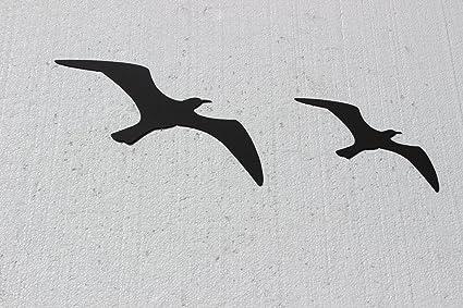 Amazon.com: Birds in Flight Set of 2 Metal Wall Art: Home & Kitchen