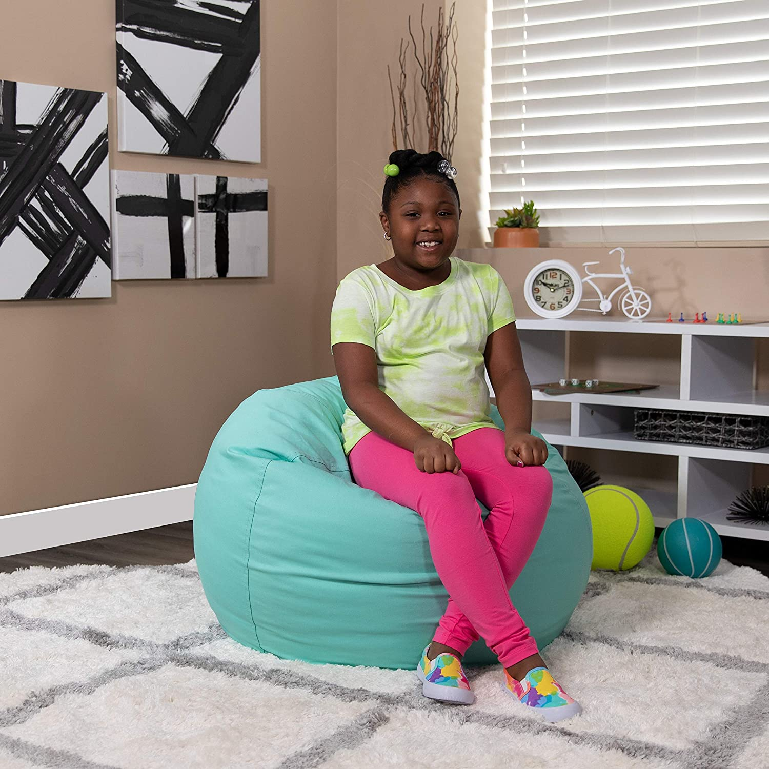 Student sitting on a bean bag.