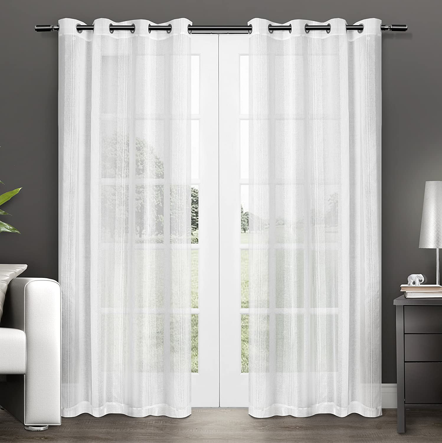 sheer curtain panels ease bedding with style. Black Bedroom Furniture Sets. Home Design Ideas