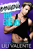 Banging the Enemy: An enemies to lovers romance