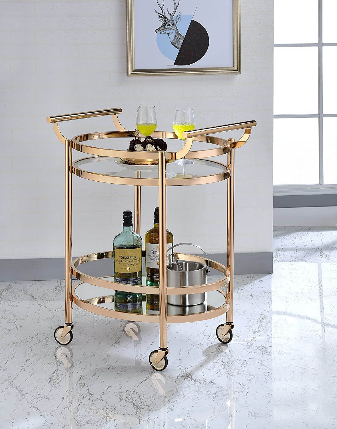Oval metal bar cart with clear glass shelves
