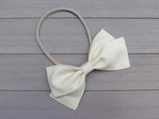 Amazon.com  Handmade Baby Girl Bow Solid Vanilla Nylon Headband or Hair  Clip fabric bow toddler headband baby hair bow infant bow headband newborn  headband  ... 7e83ba14123