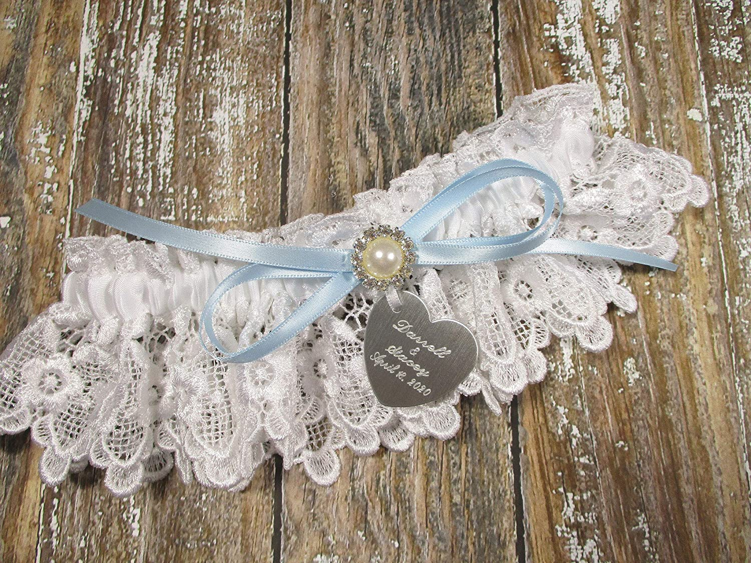 White Lace Wedding Garter with a Blue Bow and Blue Crystal with Personalized Engraving