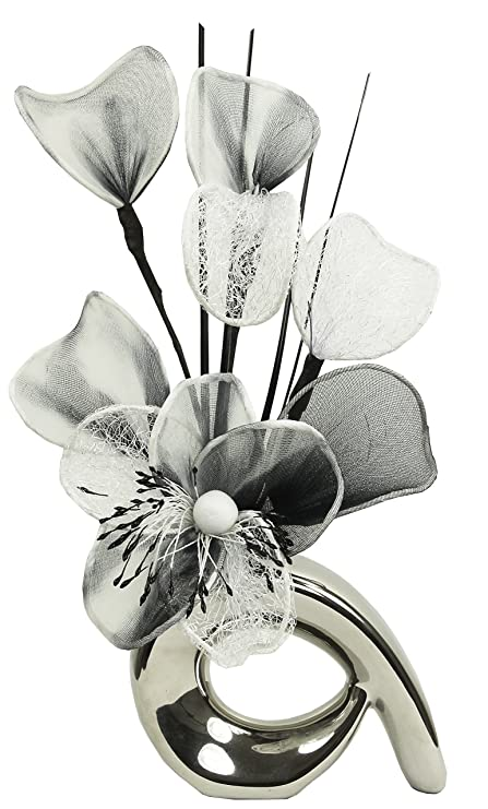 Silver vase with white and black artificial flowers ornaments for living room window sill