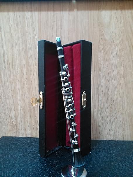 Clarinete negro decorativo en miniatura. Con soporte metálico y estuche: Amazon.es: Hogar