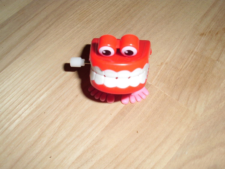 goki 13182 Zähne zum Aufziehen, 5 x 4 cm, Kunststoff, rot/rosa (1 Stück) Gollnest und Kiesel