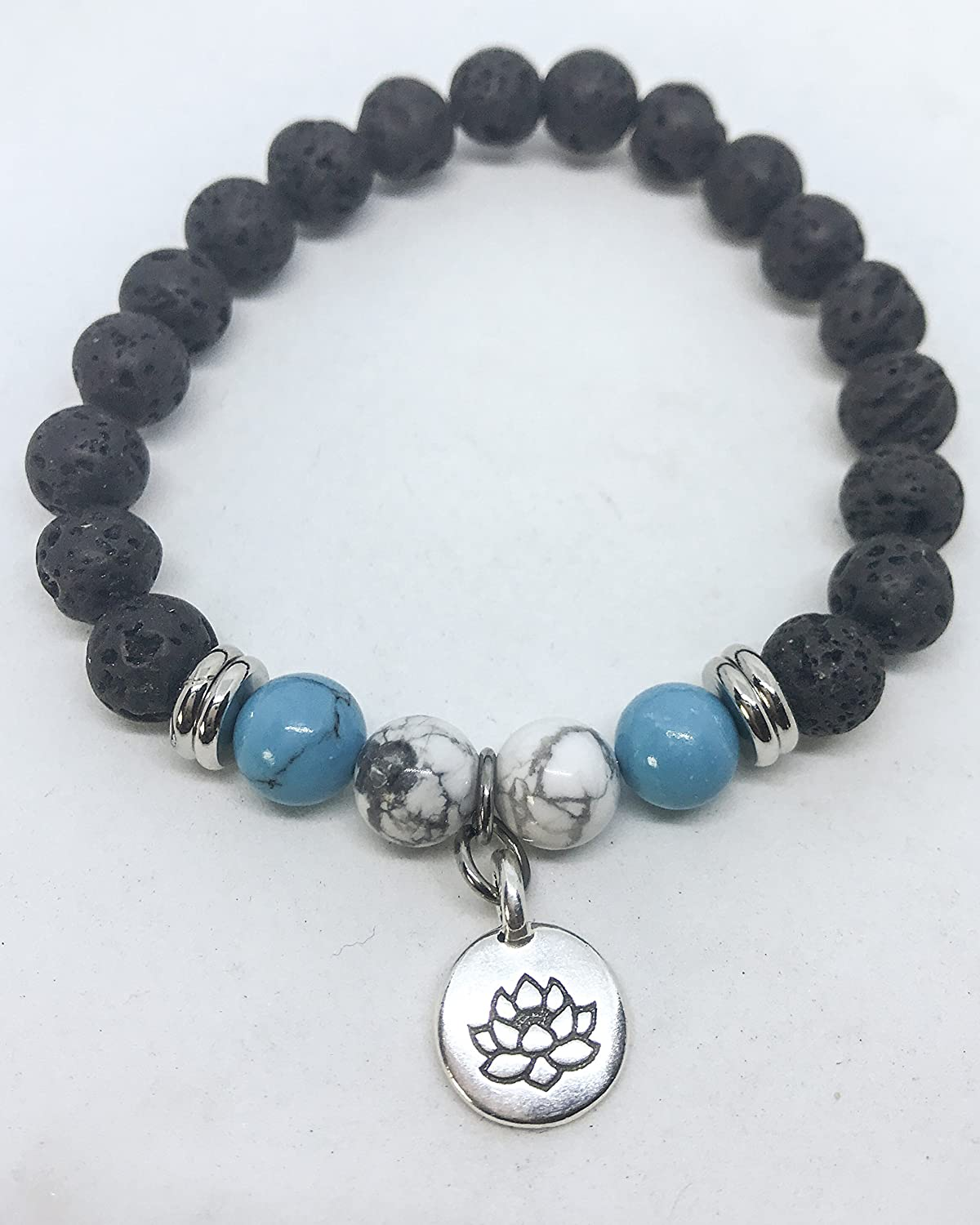Aromatherapy Diffuser Bracelet with Turquoise, White Howlite and a Lotus Charm