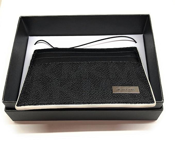 ad52cba31b3f Michael Kors Men s Jet Set Tall Logo Card Case Black White  Amazon.in   Clothing   Accessories