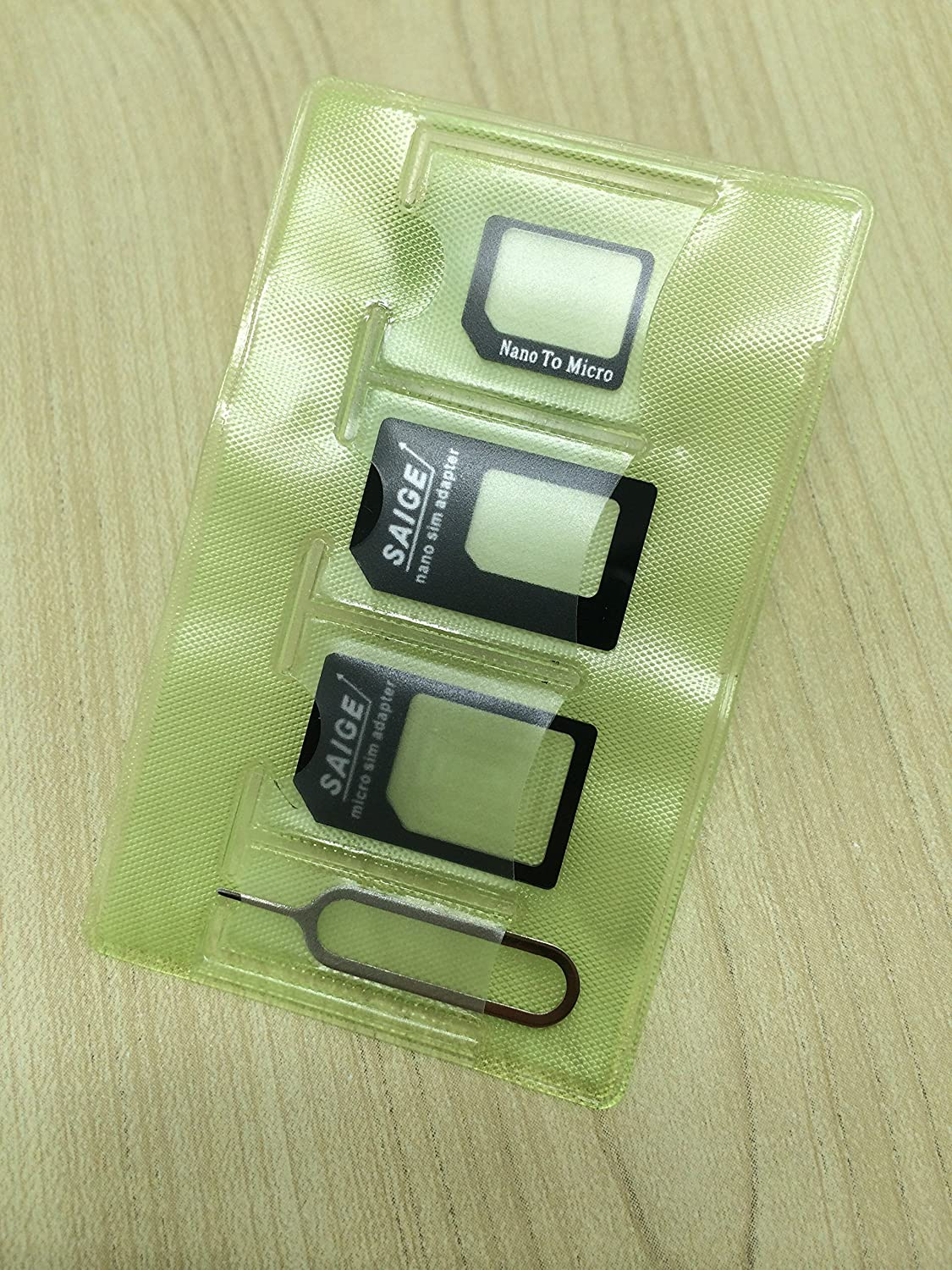 1 Iphone Eject Pin tool as picture display. 4 in 1 SIM Card adapter Storage Holder with 3 pcs Adapters Noting:NO Memory card Black 4 in 1