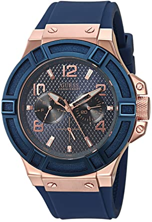 896652331b4c Amazon.com  GUESS Rigor Iconic Blue Stain Resistant Silicone Watch with  Rose Gold-Tone Day + Date. Color  Blue (Model  U0247G3)  guess  Watches