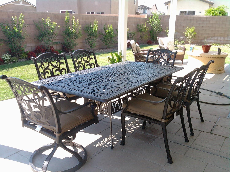 Amazon com heritage outdoor living flamingo cast aluminum 7pc outdoor patio dining set with 44x84 rectangle table antique bronze garden outdoor