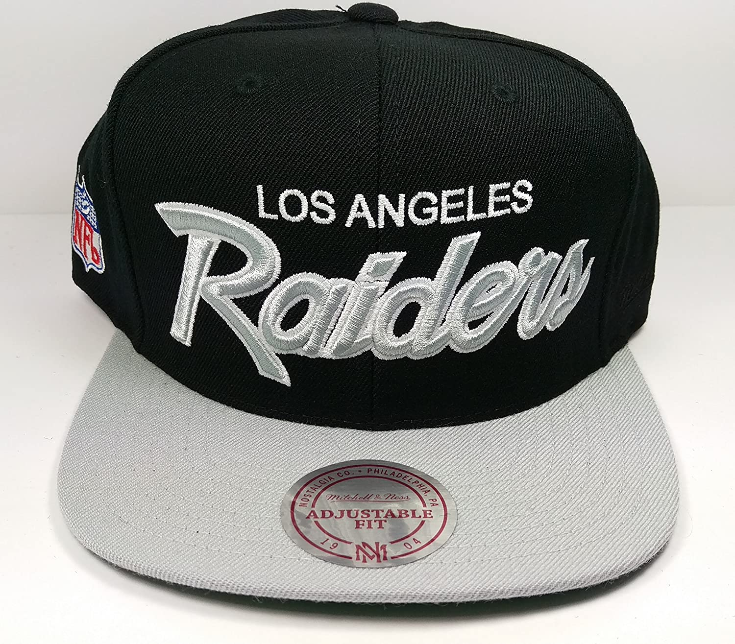 582e1ba45f17d Mitchell & Ness Los Angeles Raiders Black and White Vintage Script N.W.A  Adjustable Snapback Hat NFL