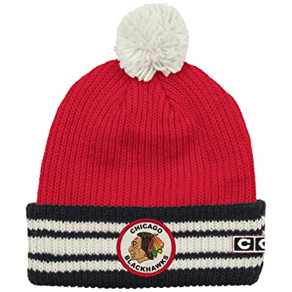 d09c77334c3 Image Unavailable. Image not available for. Color  Reebok Chicago Blackhawks  Watch Cap Cuffed Knit Hat with Pom
