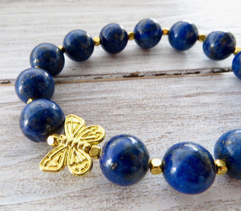 20d747db0782 Pulsera elastica de lapis lazuli azul y mariposa dorada