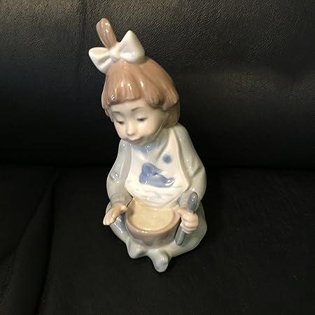 LLADRÓ Nao Porcelana Figura Decorativa niño Comiendo gachas Hecho en España by: Amazon.es: Hogar