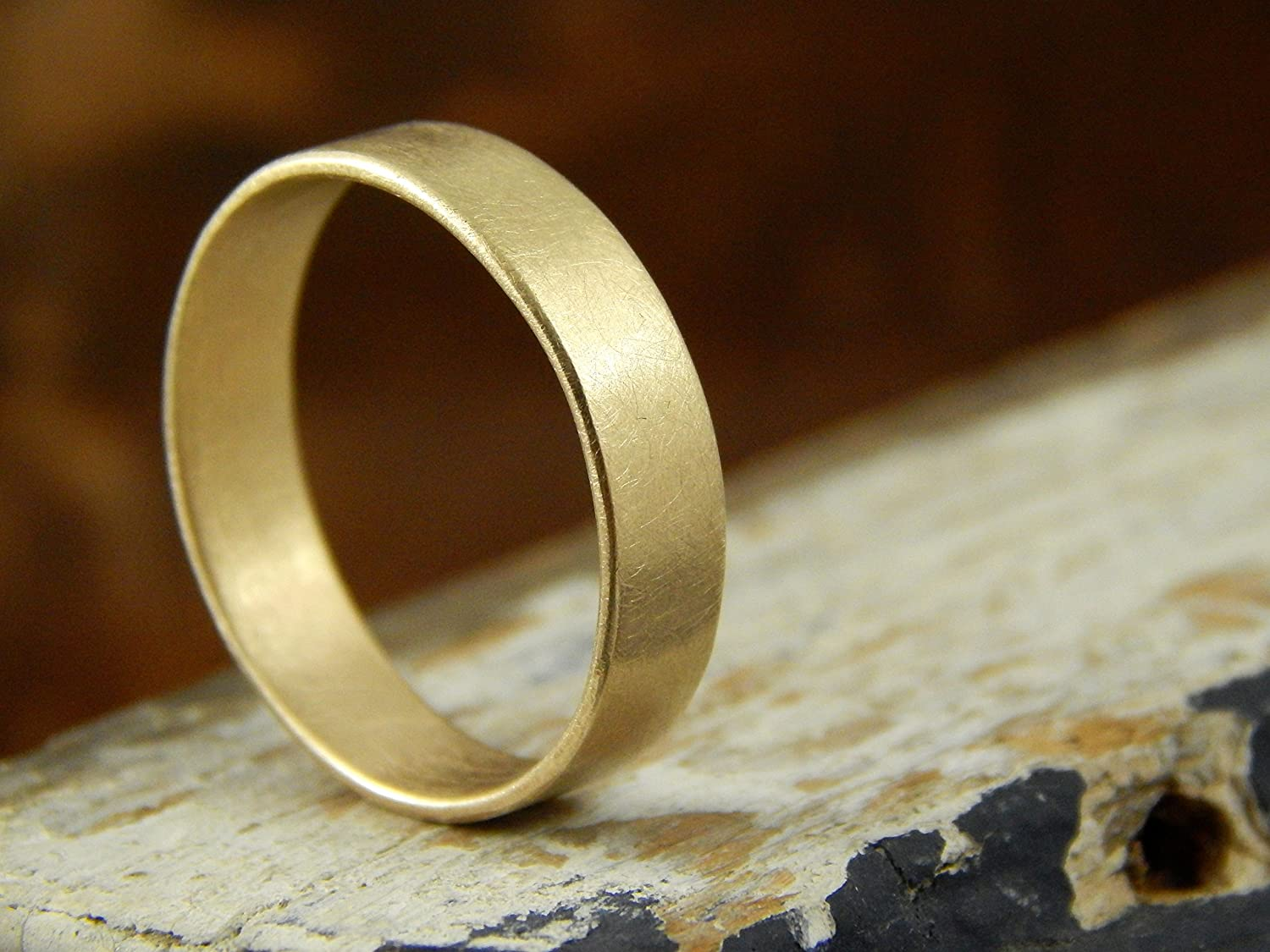 This is a photo of Amazon.com: 42 mm gold wedding band, 42k solid yellow gold band