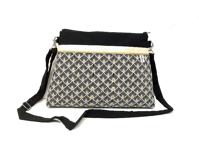 cfa70754ee sac bandouliere noir et blanc a motifs geometriques , sac zippé en toile et  tissu style