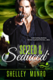 Seized & Seduced: A paranormal shifter menage mmf romance (House of the Cat Book 3)
