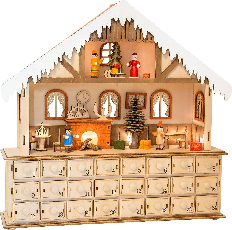 small foot Holz Form, 24 Schubladen mit kleinen Knäufen als Griff, sowie fein gearbeiteter Inneneinrichtung des winterlichen Hauses und Innenbeleuchtung Adventskalender