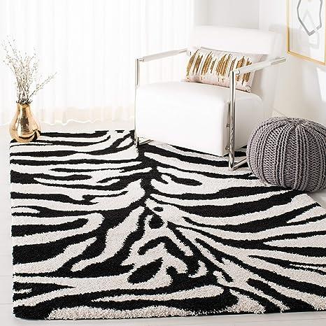 Amazon Com Safavieh Florida Shag Collection Sg452 Zebra Print 1 2 Inch Thick Area Rug 4 X 6 Ivory Black Furniture Decor