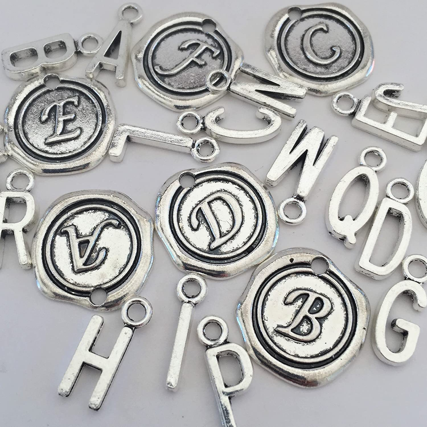Add An Initial To your Otterly Charming Bracelet Or Necklace