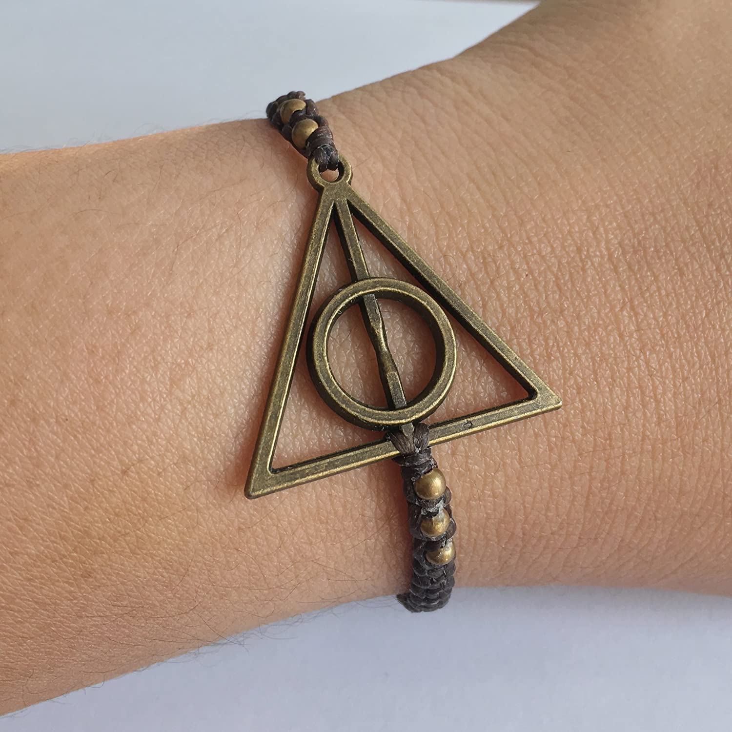Eli and Andi Mens Womens Harry Potter Deathly Hallows Inspired Brass Charm Adjustable Bangle