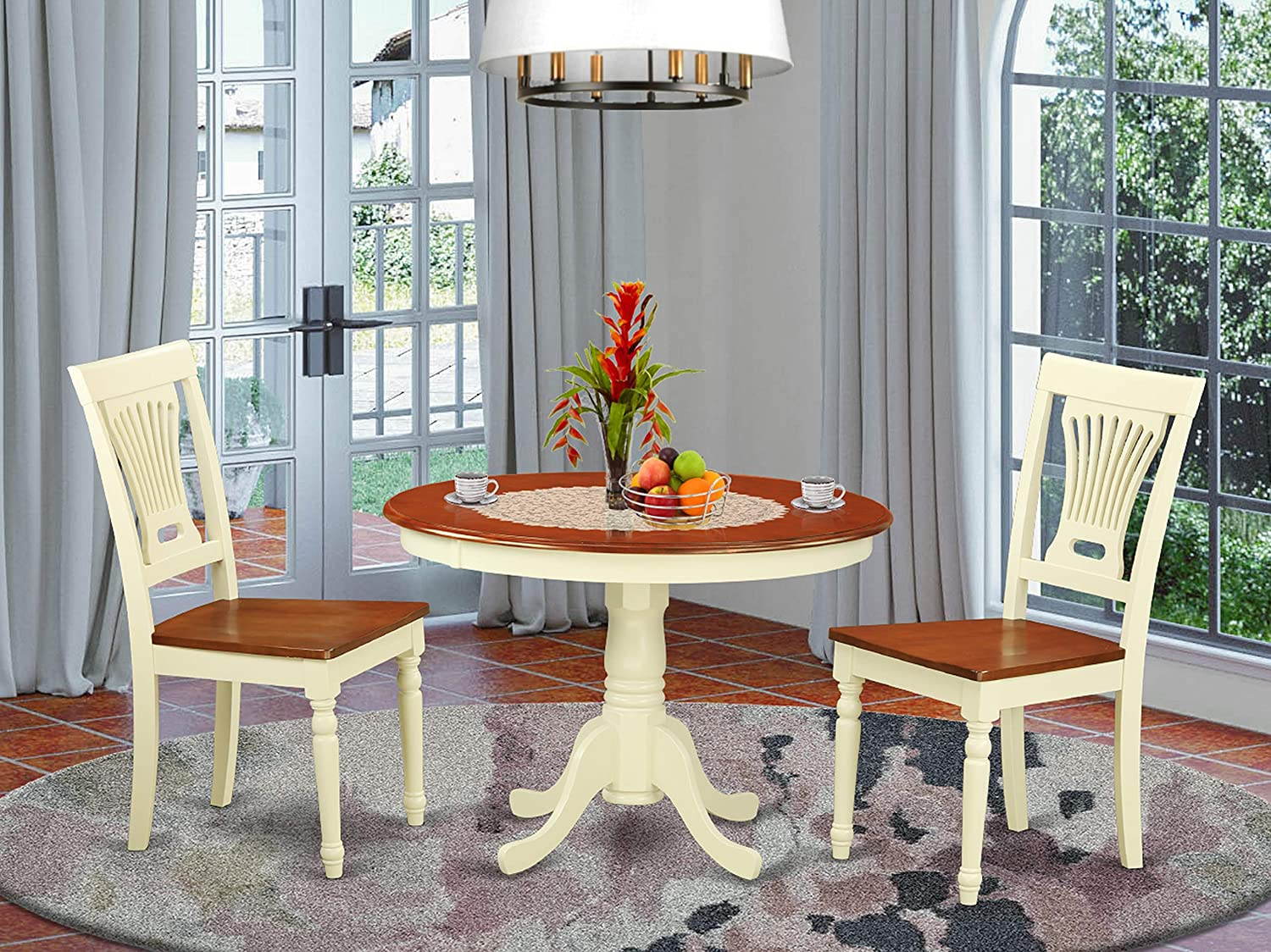 3 Pc set with a Round Dinette Table and 2 Wood Dinette Chairs in Buttermilk and Cherry .