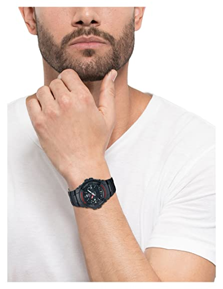 man wearing classic analog watch
