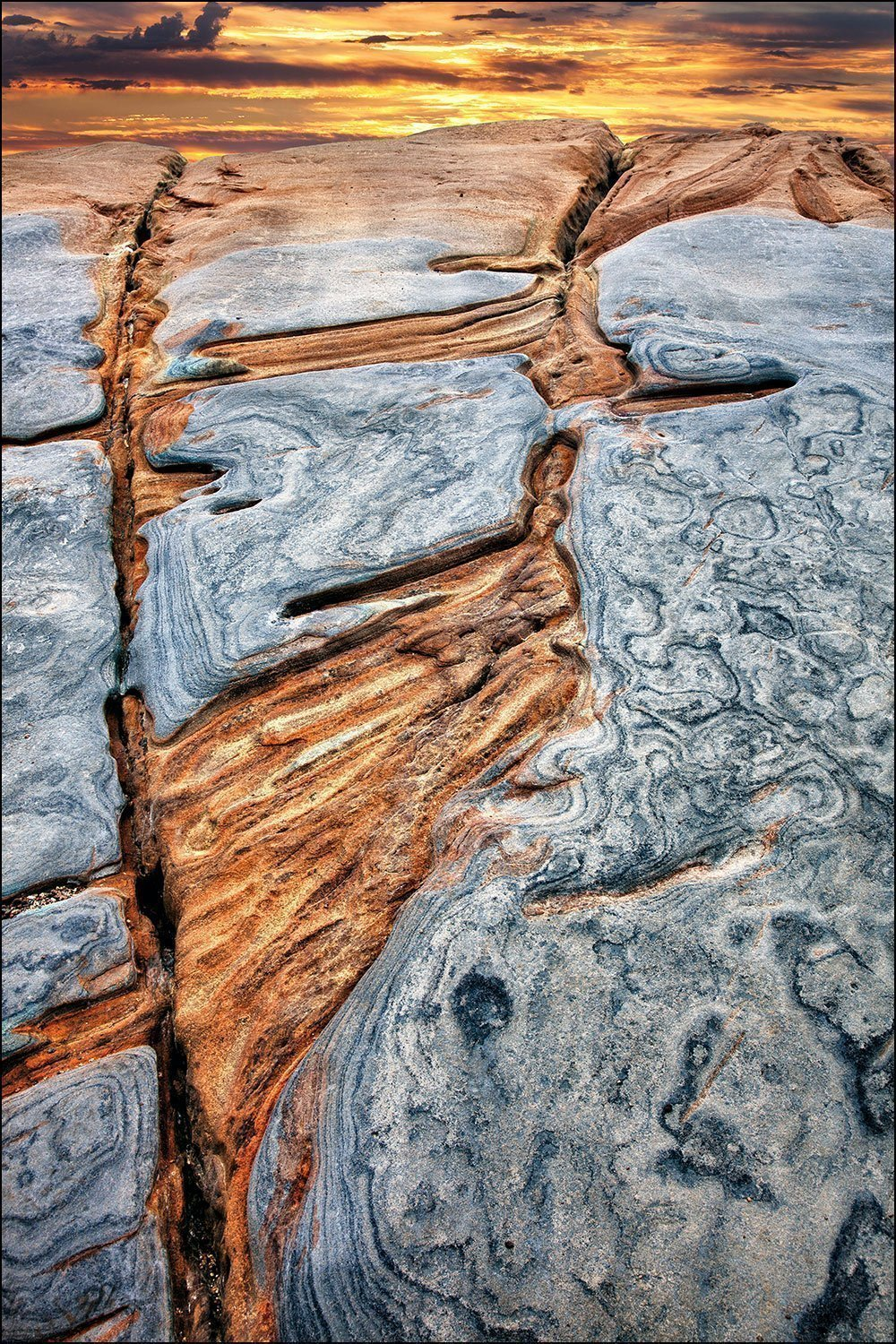 Photograph of abstract rock patterns at Pacific ocean shore sunset. by Bob Estrin Fine Art Photography