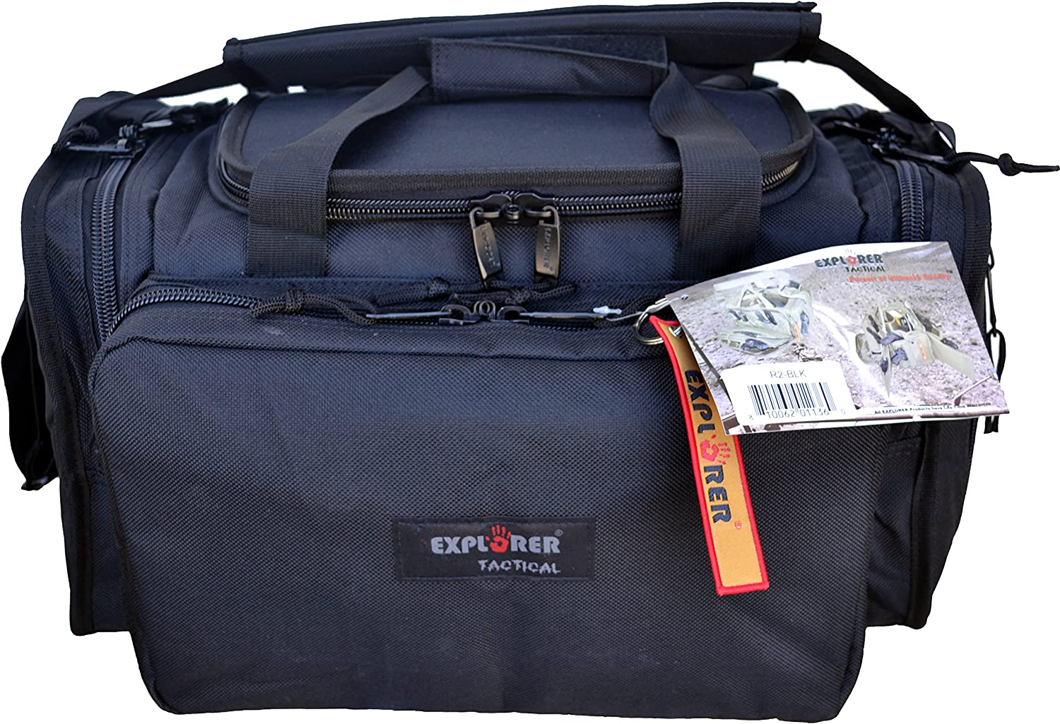 Photo of a range bag in blue color, one big front pocket with zipper closure with product patch at the center, a bag tag hanging from it.