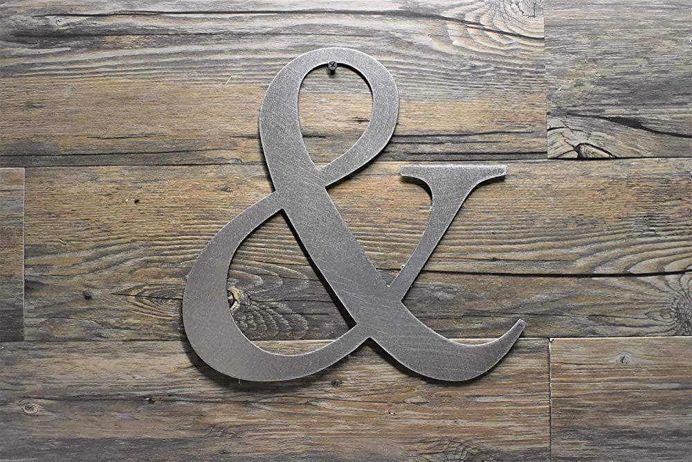 Ampersand sign metal steel wall writing