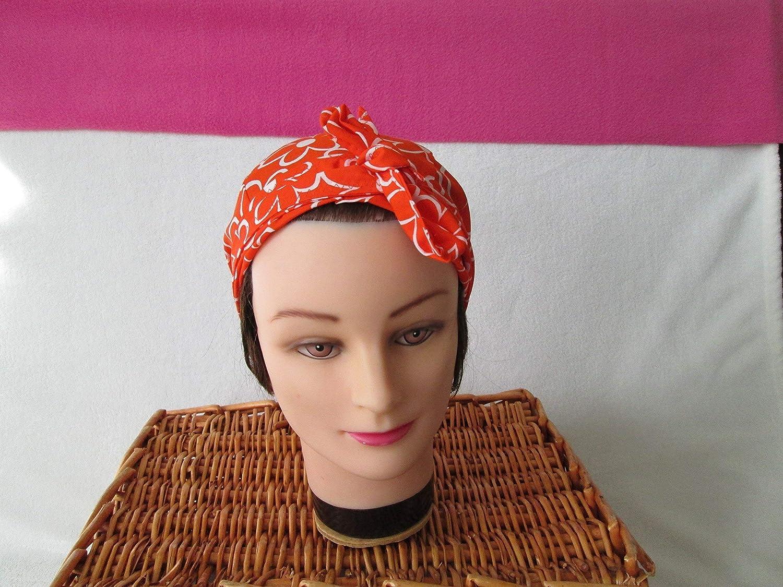 Foulard, turban chimio, bandeau pirate au féminin orange avec des grosses fleurs blanches