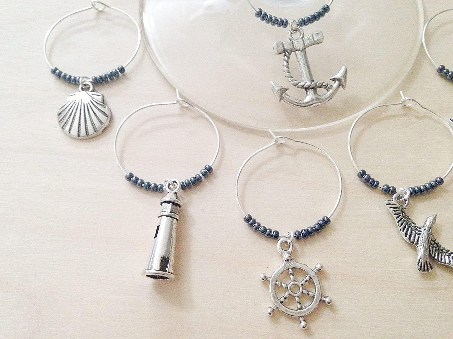 Nautical Themed Wine Charms, Ships Ahoy, Sailing gift for one who loves the Sea. Includes Anchor, Ship Wheel, Lighthouse, Sailboat etc. Stocking Stuffer for Beach lover. Set of 4 to Set of 6.